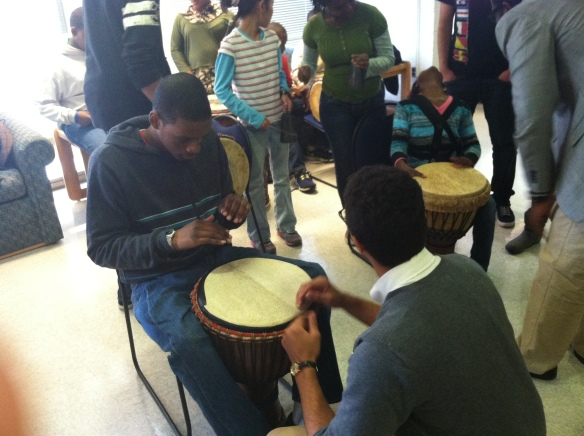 Here is one priceless Ase moment when Chris Croft, a member of African Rhythms taught an Ase 8th grader how to drum.