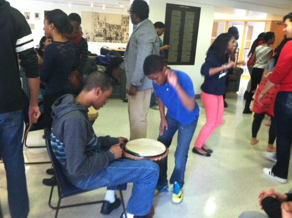And here is the same 8th grade student passing on the tradition by teaching a new 6th grader how to drum.